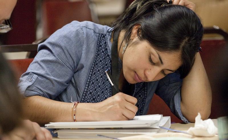 female student writes notes