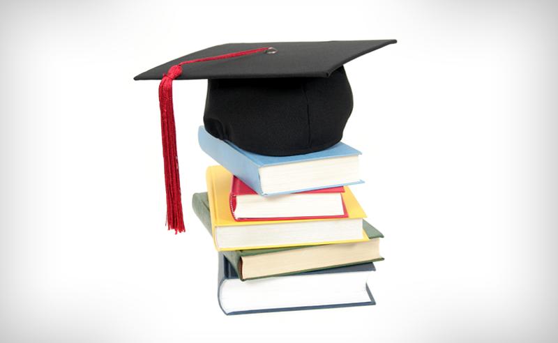 Graduation cap on top of text books