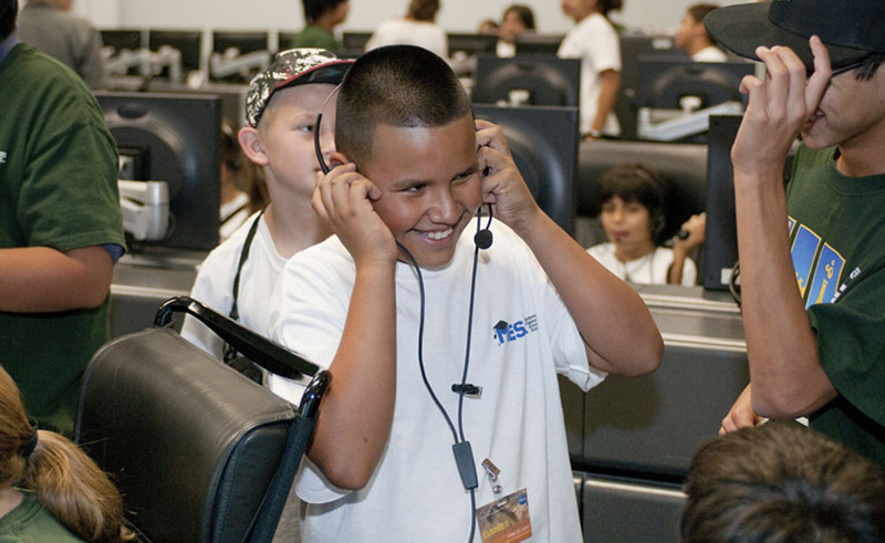 boy playing with a headset and microphone